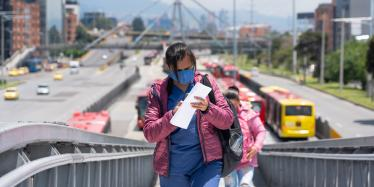 Woman wearing a face mask on a bus station in Bogotá, Colombia, 28 April 2020