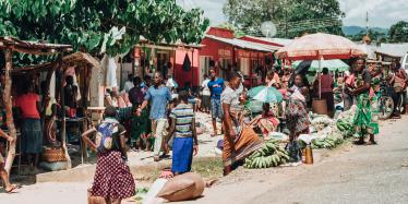 Local people on the street market, stall with tropic fruits on the market place in Mzuzu, Malawi.
