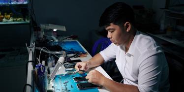 repairman fixing smartphone